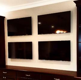 4 flat screens on 1 wall, multiple tvs mounted on same wall, professional flat screen tv mounting in charlotte