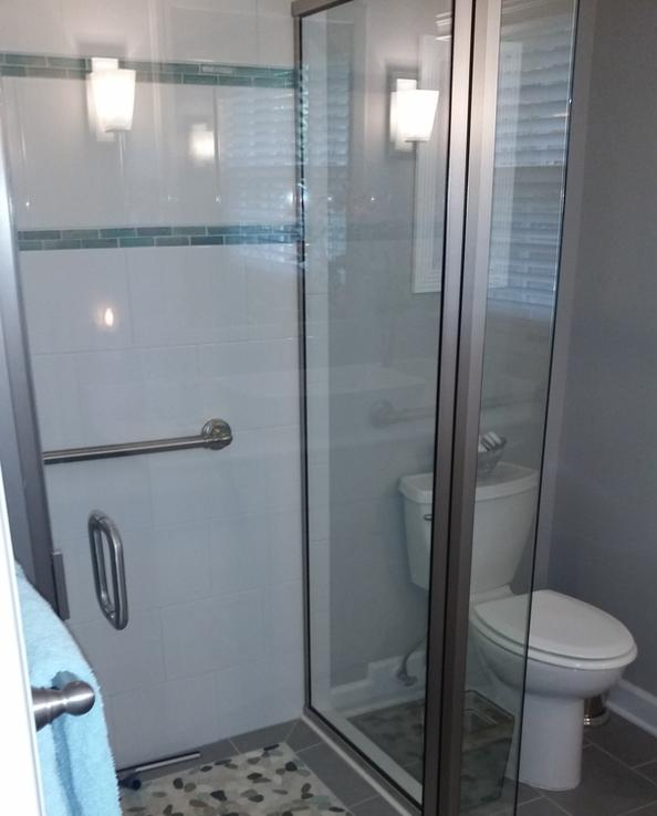 Framed shower stall in basement bathroom after renovation