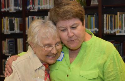 Photo of two FriendShip participants hugging.