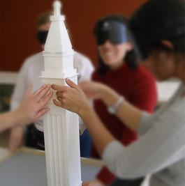 Photo of people touching clocktower model