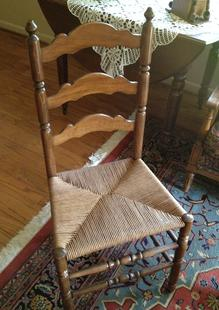 A Chair with a woven seat.
