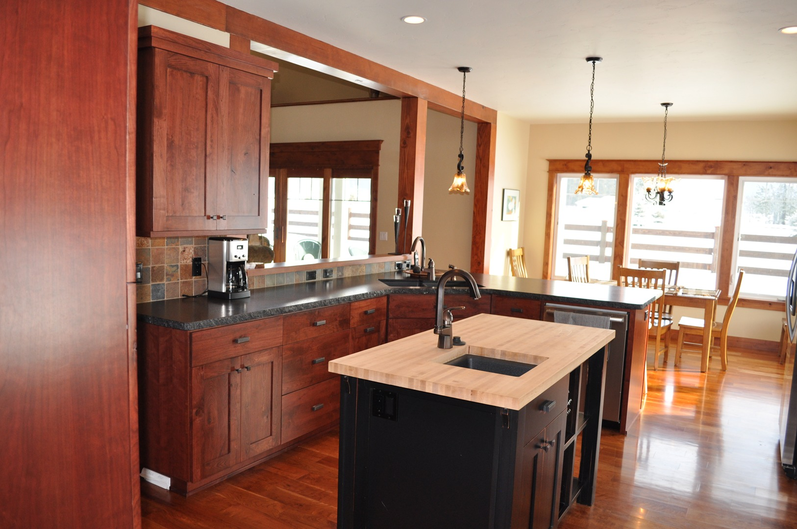 c brown peninsula traditional kitchens medium pictures staggered kitchen golden cabinets wood of