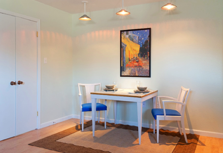 The dining area at the Salon at Blan's House, a furnished, one-bedroom, short-term corporate rental apartment.