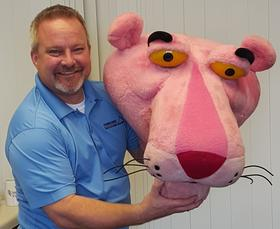 Pete Hosbach Holding the Owen Corning Pink Panther Head