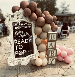 Ready to Pop Baby Shower welcome sign with boho balloon garland and baby blocks