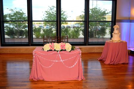 pink wedding roses and cake table