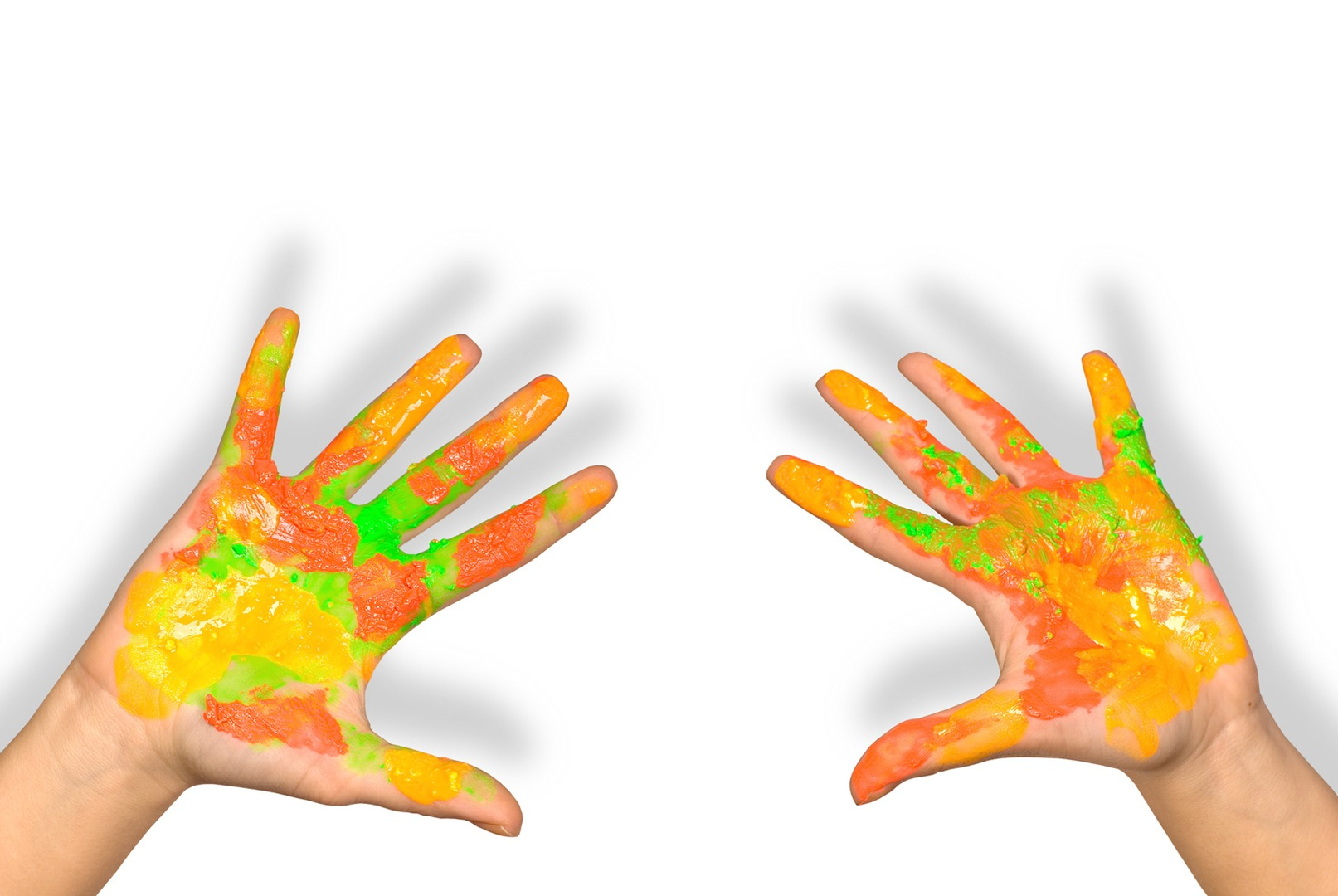 kid hands with a lot of colours