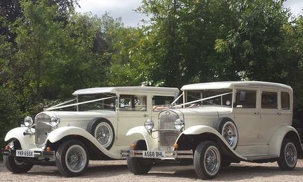 Vintage style wedding cars in Ivory, pictured are the Brenchley Landaulette and Barnsdale saloon available from Essex Wedding Cars