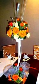 orange roses and stars centerpieces