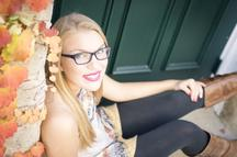 photo by shrinking buffalo productions - high school senior female sitting in doorway