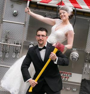 Fun Newlywed pose for a fireman and bride on their wedding day in Minnesota