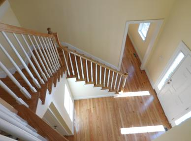new staircase finished by Adelphia Contracting