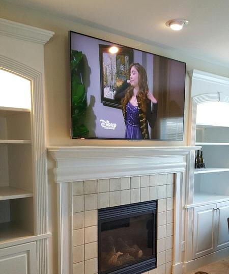 tv over fireplace mounting and installation services charlotte nc. Black Bedroom Furniture Sets. Home Design Ideas