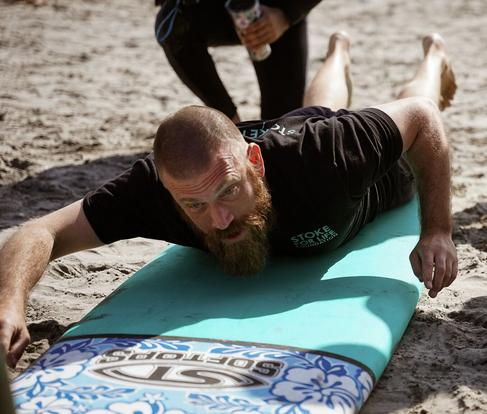 "Blind Surfer Josh ""the Jedi Loya teaching a surf lesson on the beach. Link to Waves4all Surf Page."