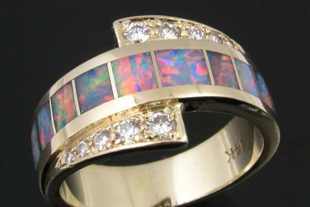 Diamond and opal ring repaired by Hileman.