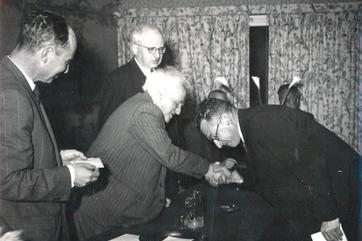Oren, the Winner, Recieving his prize from Ben Gurion. Barav on Left.