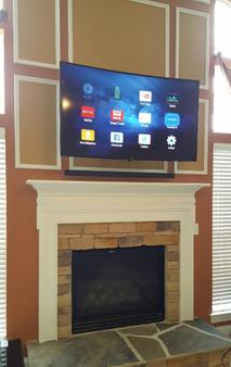 Charlotte HD TV Installers for fireplace tv mounting and wall mounting.  Professional TV mounting service