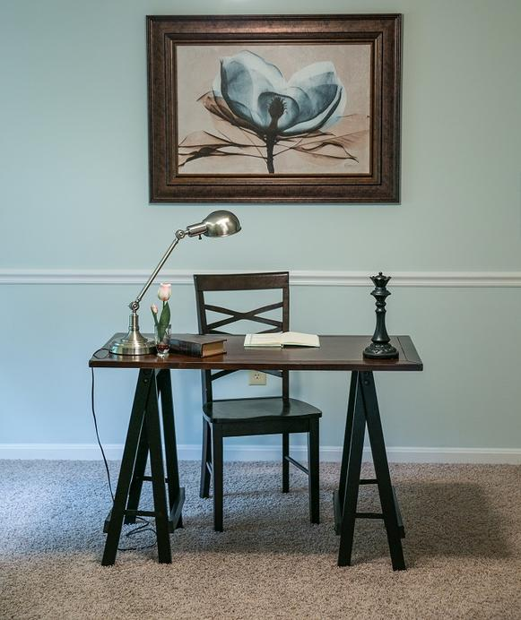 "Often, the ""extra room"" in my vacant home staging packages include an office space. Seen here is a simple desk and chair layout emphasized by an over-sized piece of art."