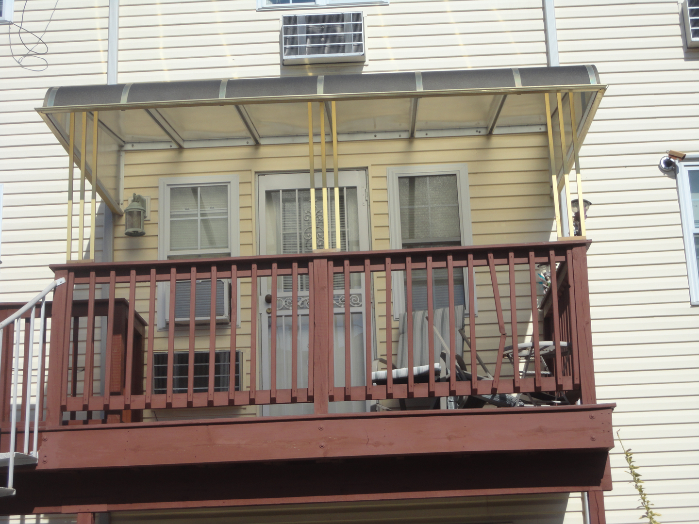 PLEXIGLASS AWNINGS COME WITH EITHER CLEAR TINTED GOLD OR GREEN POLYCARBONATED SHEETS THE FRAMES ARE MADE OUT OF HEAVY DUTY ALUMINUM METAL AND