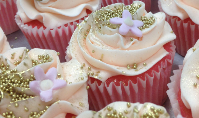 Gold and pink cupcakes, gold pearls, sugar pansies