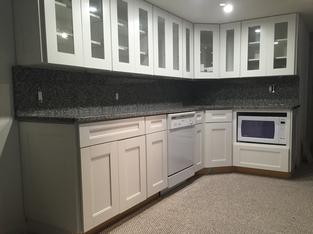 New Caledonia Granite kitchen countertop with full height backsplash, eased edge, wall outlet holes, classy on a budget