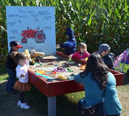 Picture Children Playing in Hank's Tractor Dig Attraction