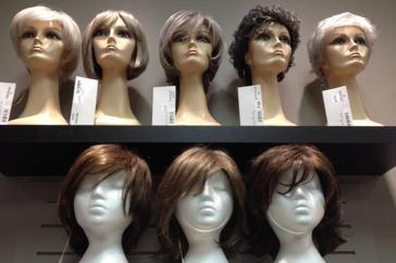 8 wigs on shelf