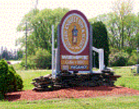 "alt=""Golden Knight Inn & Suites Sign"""