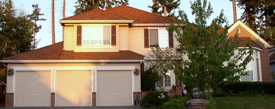 Professional garage door contractors install new garage doors.