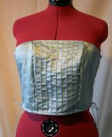 Pale blue corset with pin tuck design. Side opening.