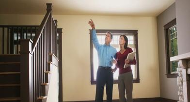 Couple inspecting the interior of a house