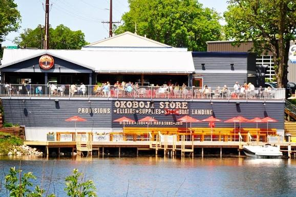 The Okoboji Store has been open since May The newly renovated restaurant has a great view of both East and West Lake with the best atmosphere in the Iowa Great Lakes.