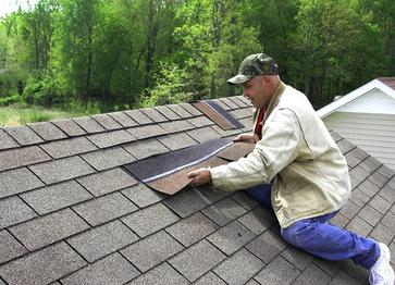 A man lays new roofing in Rockwall, TX