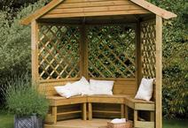A beautiful gazebo with bench seating and lattice backing.