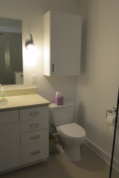 Comfort height toilet and raised vanity cabinets help make this bathroom more accessible.