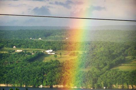 "alt=""Seneca Lake Hillside with Bright Rainbow"""