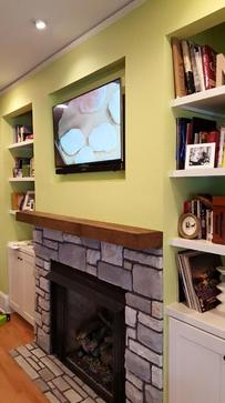 flat screen tv mounted over fireplace by charlotte nc best tv mounting service, carolina custom mounts