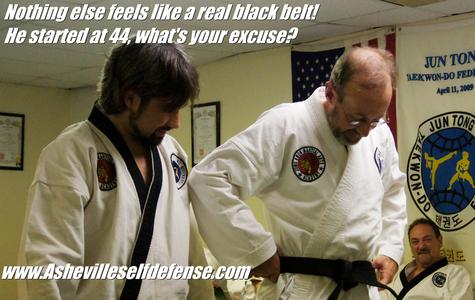 Dan putting on his first black belt, at age 47. Middle age is not a problem for us!