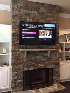 flat screen 4k ultra flat screen tv mounted on stacked stone fireplace in charlotte nc, we mount tvs on fireplaces in charlotte nc