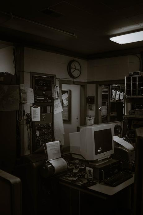 gloomy black and white office space at night