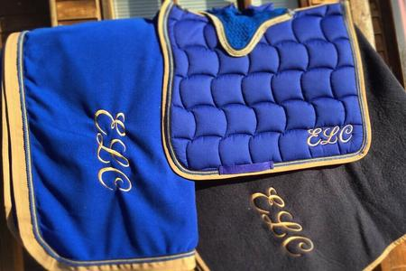 Personalised rugs, saddle cloths, embroidery, monogram,