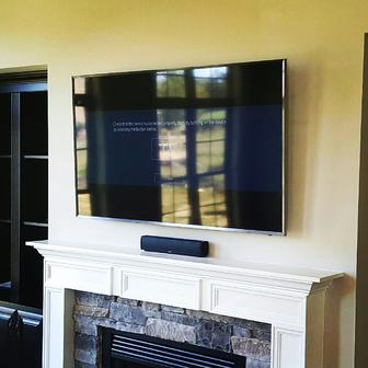 Flat screen tv over fireplace installatiion service in charlotte, flat screen mounted over fireplace with mounted speaker