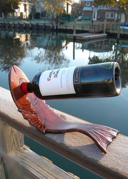 Easy DIY Nautical themed craft projects. Fish shaped nautical wine bottle stand. www.DIYeasycrafts.com