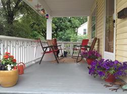 Ellie Hadsall's serene front porch with flowers, Cosmic Gathering