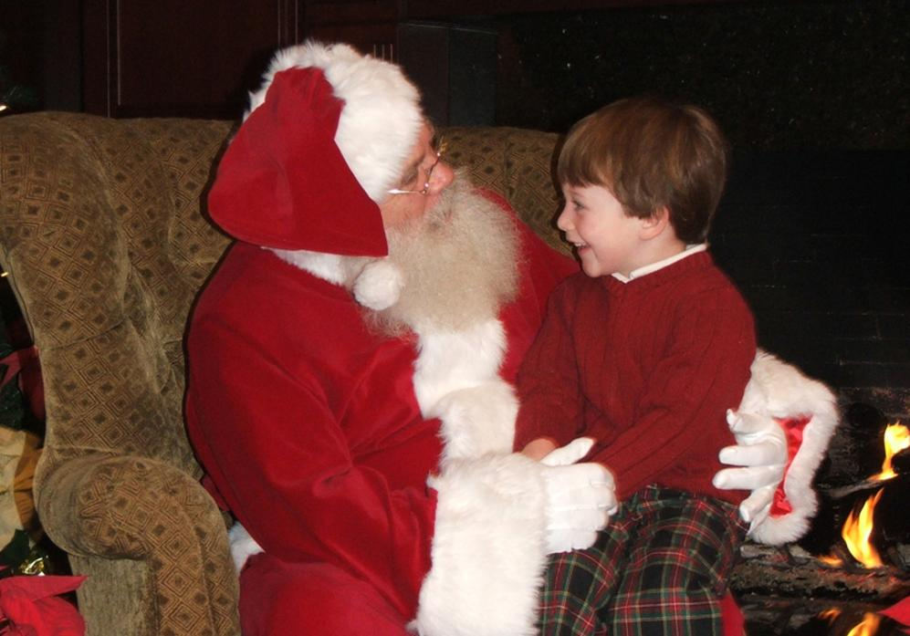 Child with Santa at a Company Christmas Party