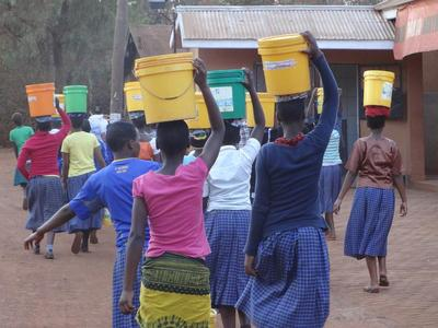 Students at Dageno Girls Center carrying water buckets.