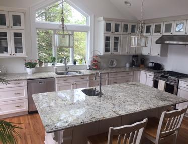 Snowfall Granite Kitchen Countertop with Ogee Edge and Stainless Steel Sink fabricated in Delaware