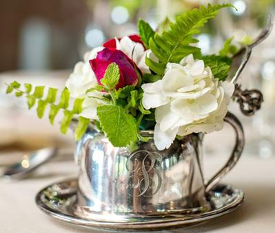 Silver cup with floral arrangement as centerpiece