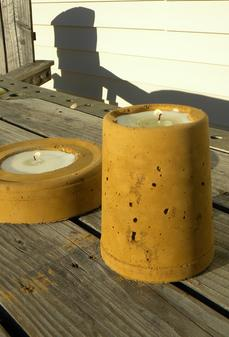 Easy DIY Outdoor and Backyard crafts and projects. Outdoor cement candle holders. www.DIYeasycrafts.com