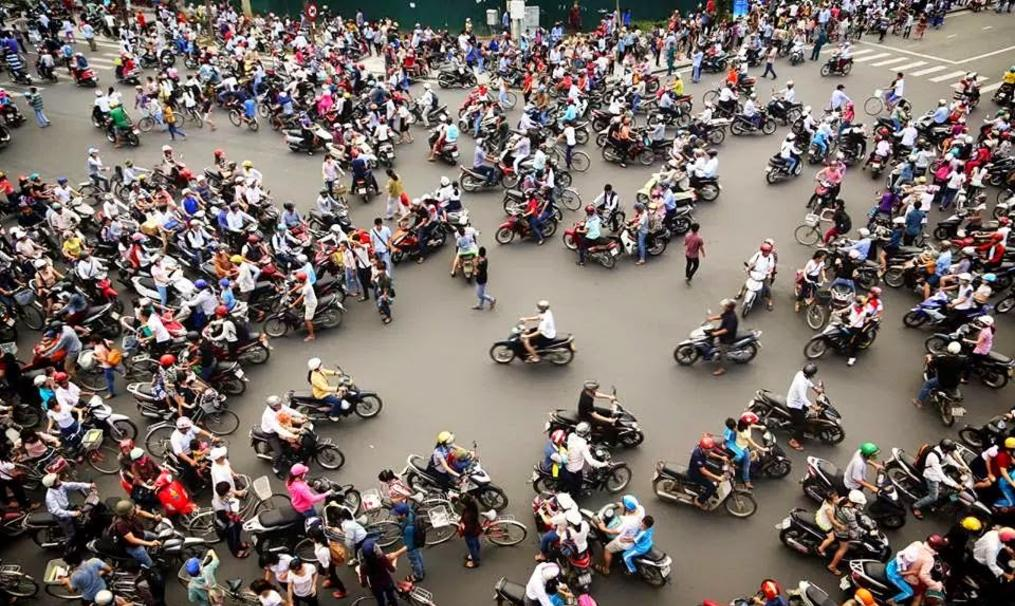 image of about 1000 motorbikes going all directions looking like chaos.